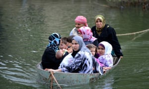 Syrian refugees cross by boat to Turkey over the Orontes river on the Turkish-Syrian border near Hacipasa village in Hatay, Turkey.