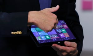 Microsoft CEO Steve Ballmer shows a Surface tablet before the launch of Windows 8 operating system in New York.