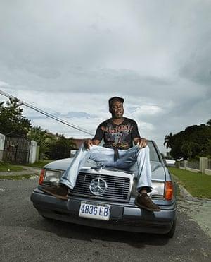 Jamaican Musicians: Deejay and producer Jah Thomas wearing desert treks, New Kingston, 2011