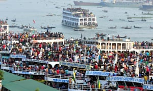 People pack ferries and boats on the river Burigunga, Dhaka, Bangladesh. Some even defy the law to jump on roofs at the Sadare gate launch terminal in order to reach their homes ahead of Eid Al-Adra.