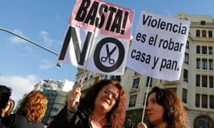 Civil servants hold placards as they protest against austerity measures in central Valencia, October 26, 2012