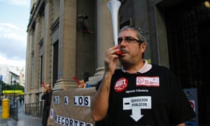 A protestor blows a vuvuzela as civil servants protest against austerity measures in central Valencia, October 26, 2012.