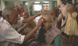 A woman donates her hair for auction at the Tirumala temple in India 0f457203b