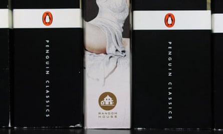 Spines of Penguin books beside a Random House book