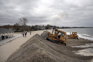 Hurricane Sandy : Earth movers build protective berms on Compo Beach in Westport, Connecticut