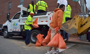 Local water and sewer authorities distribute bags of sand in downtown Washington DC