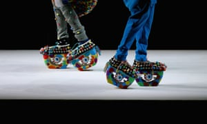 Two models show designs including bizarre footware on the catwalk during the Graduate section of China fashion week in Beijing.
