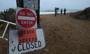 A TV crew take footage on Plum Island beach while Hurricane Sandy approaches New England in Newbury, Massachusetts.