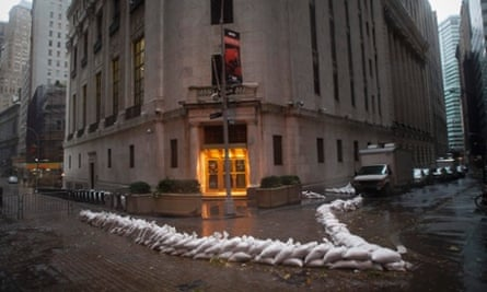 Sandbags block the entrance of the New York Stock Exchange in downtown Manhattan as Hurricane Sandy approaches the city.
