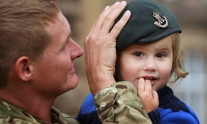 Lance Corporal Philip Davies from the 3rd Battalion The Rifles with his son Benton at Redford Barracks, Edinburgh after returning from serving in Afghanistan.
