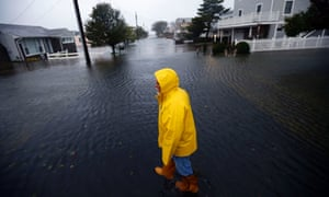Al Daisey walks in the flood water in front of his home in Fenwick Island, Delaware as Hurricane Sandy bears down on the east coast of the US.