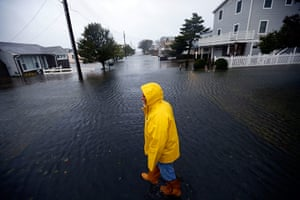 Hurricane Sandy : Al Daisey walks in the flood water in front of his home