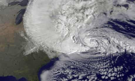 A dramatic satellite image provided by NASA: Hurricane Sandy, pictured at 1240, churns off the east coast in the Atlantic Ocean.