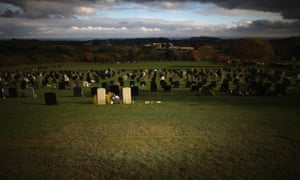 Recently laid turf is all that marks the grave of Jimmy Savile at Woodlands Cemetery in Scarborough on the first anniversary of his death, October 29.