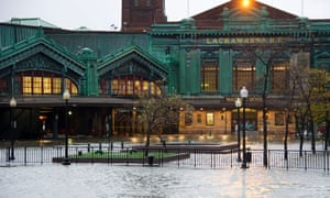 The Hudson river rises over its banks flooding the Lackawanna train station as Hurricane Sandy approaches, in Hoboken, New Jersey on Monday.