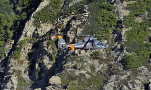 An helicopter of the French navy flies over the Porquerolles island, southeastern France to search for a 12-year-old British boy, who disappeared over the weekend. Sixty soldiers and three civil security dog-handlers from Brignoles are participating in the search.