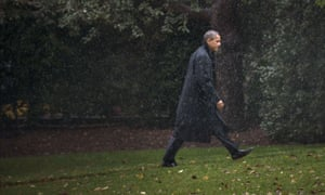 Under a cloud: President Barack Obama walks back to the West Wing of the White House after returning from campaigning to monitor Hurricane Sandy as it makes landfall.