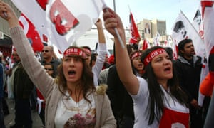 Women shout slogans as they march with thousands of people towards the mausoleum of Ataturk to celebrate the country's Republic Day in Ankara, Turkey. Thousands of pro-secular Turks marched defying a ban by the moderate Islamist government.