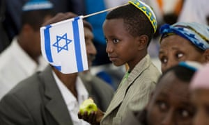 A newly immigrated Ethiopian Jewish boy attends a welcoming ceremony at Ben Gurion airport near Tel Aviv, Israel. About 240 Ethiopian Jews arrived today as part of Operation Dove's Wings aimed to bring the remainder of the Falash Mura, a group of Ethiopians Jews, to Israel.