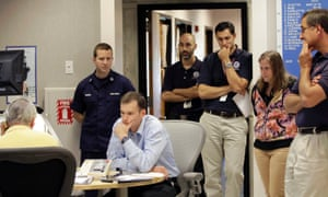 Their faces say it all. Hurricane Centre staff convene for a forecast meeting at the National Hurricane Centre in Miami. Forecasters expect the hurricane to make a westward lurch and aim for the coast of New Jersey, blowing ashore Monday night or early Tuesday.