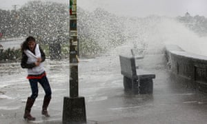 Time to head inside. A woman reacts to waves crashing over a seawall in Narragansett, Rhode Island as Hurricane Sandy continues on its path.