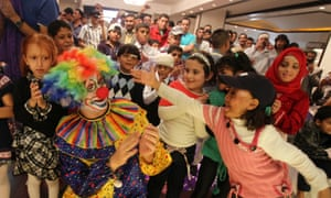 Syrian and Iraqi refugee children who were injured during violence in their countries play during an Eid al-Adha party organized by the French aid organization Medicins Sans Frontieres in Amman, Jordan.