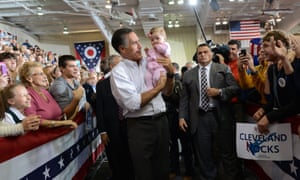 US Republican presidential candidate Mitt Romney holds a supporter's baby during a campaign rally at Avon Lake High School in Avon Lake, on Ohio.