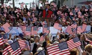 A sea of star spangled banners: Republican vice presidential candidate Paul Ryan gestures while speaking  during a campaign event in Fernandina Beach, Florida.