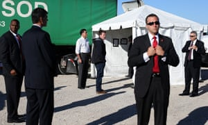 U.S. Secret Service agents surround Republican presidential candidate, former Massachusetts Gov. Mitt Romney (3rd L) and his personal aide Garrett Jackson as they wait backstage before a campaign rally at Seven Cities Sod in Davenport, Iowa.