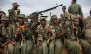 Fighters of the Ras Kimboni brigade, a Somali government allied militia, sitting on the back of a machine gun mounted battle wagon as they wait to join troops from the Kenyan Contingent of the African Union Mission in Somalia (AMISOM) ahead of an advance on the Somali port city of Kismayo Kenya.