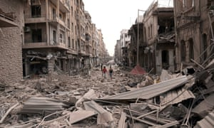 In this photo released by the Syrian official news agency SANA, Syrian men walk at a street between destroyed buildings where triple bombs rocked at the Saadallah al-Jabri square, in Aleppo city, Syria.