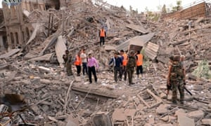 Men stand amid wreckage, after three blasts ripped through Aleppo's main Saadallah al-Jabari Square, and a fourth was reported a few hundred metres away near Bab al-Jinein. The Syrian Observatory for Human Rights said at least 40 people were killed and 90 wounded, citing medical sources.