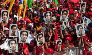 Supporters of Venezuela's President Hugo Chavez hold portraits of Venezuela's independence hero Simon Bolivar during a campaign rally in Yaracuy, Venezuela.