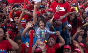 A very excited crowd cheer for president Hugo Chavez during a campaign rally in Barquisimeto, Venezuela.