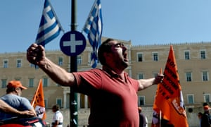 A municipal worker shouts slogans during a demonstration outside the Parliament in Athens on October 3, 2012.