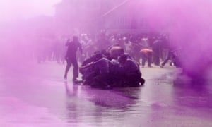 Purple rain: Police use colored water from a water cannon to disperse Kashmiri teachers during a protest demanding a hike in salary and regularisation of their jobs in Srinagar, India.