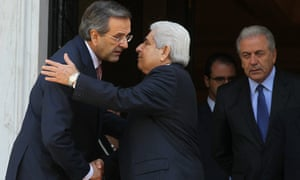 Greek Prime Minister Antonis Samaras (L) bids farewell to the President of Cyprus, Dimitris Christofias (C), after they finished their meeting in Athens, Greece, 02 October 2012.