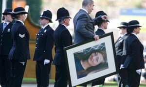 A photograph of Police constable Nicola Hughes is carried from Manchester Cathedral after her funeral service.  Photograph: Phil Noble/Reuters