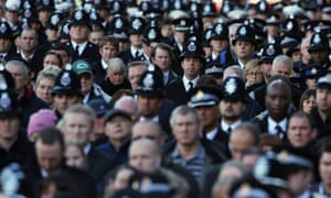 Police Officers watch a screening of the service of the funeral of Police Constable Nicola Hughes.