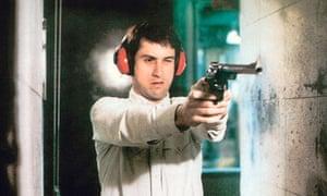 Robert De Niro firing a gun in Taxi Driver