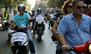 Municipal workers drive their motorcycles during a protest against the new austerity measures in the northern port city of Thessaloniki, Greece, on Wednesday, Oct. 3, 2012.