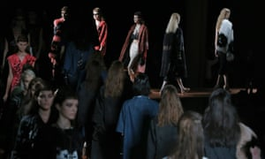 Models wear creations for Miu Miu Spring/Summer 2013 collection during the last day of Paris Fashion Week.