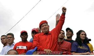 Venezuelan President Hugo Chavez raises