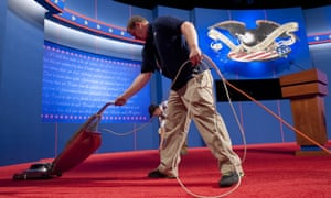 Shaun Spink with the University of Denver vacuums on the stage prior to the first presidential debate at Magness Arena at the University of Denver in Denver, Colorado, October 3, 2012.