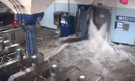 Floodwaters from hurricane Sandy rush down an elevator shaft into Hoboken subway station in New York