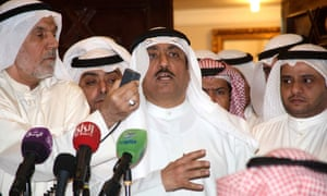 Former Kuwaiti opposition MP Musallam al-Barrak  addresses supporters who gathered outside his residence in the Al-Andalus district of Kuwait City on Monday following reports that a warrant had been issued to arrest him for making statements at a public rally deemed critical of the emir. He has since been arrested.