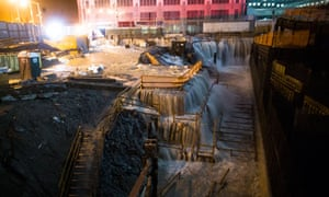Seawater floods the ground zero construction site, where One World Trade Center is being built