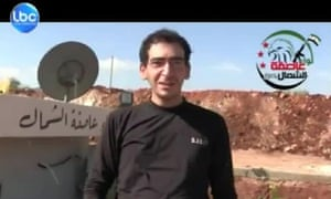 An image grab taken from a video released by Lebanese Broadcasting Cooperation news  shows abducted Lebanese journalist Fidaa Itani speaking to the camera and reassuring that he was in good health.