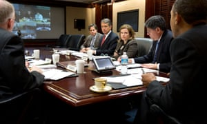 Barack Obama receives an update on the ongoing response to Hurricane Sandy on Tuesday, in the Situation Room of the White House.