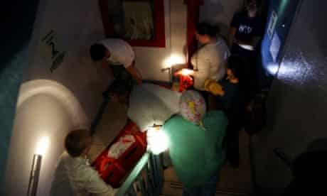 Hospital workers evacuate patient Deborah Dadlani from NYU Langone Medical Center during Hurricane Sandy.